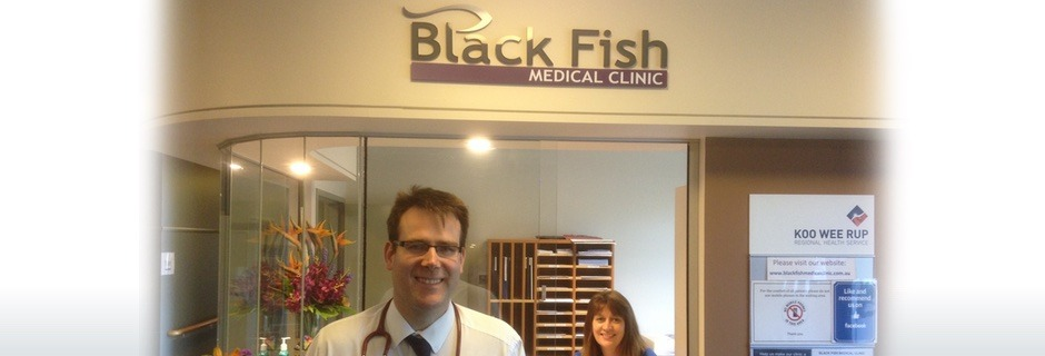 Doctor and receptionist at the Black Fish Medical Clinic