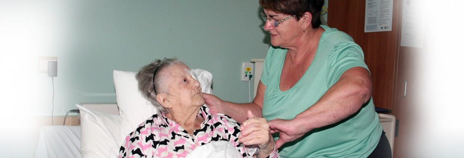 Female resident being assisted by team member