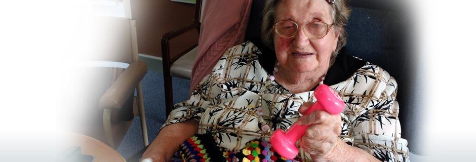 Elderly woman doing hand weights.=
