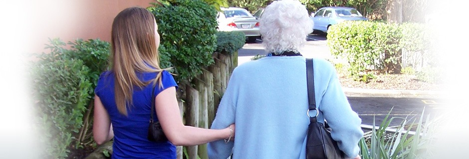 Elderly woman walking with a younger woman