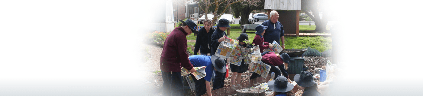 Group of people with young kids picking up newspapers