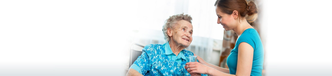 Elderly lady being assisted by younger woman